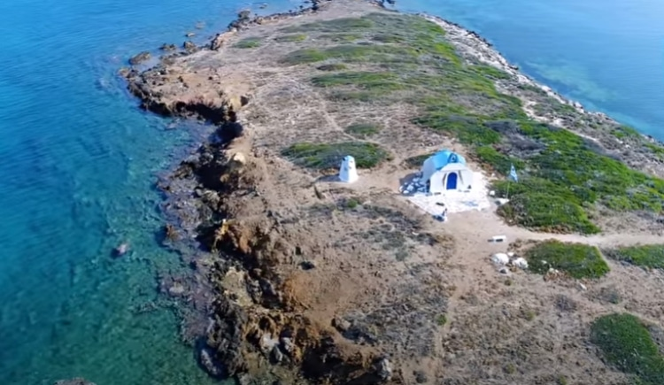 The enchanting beach and the island you go swimming in Attica