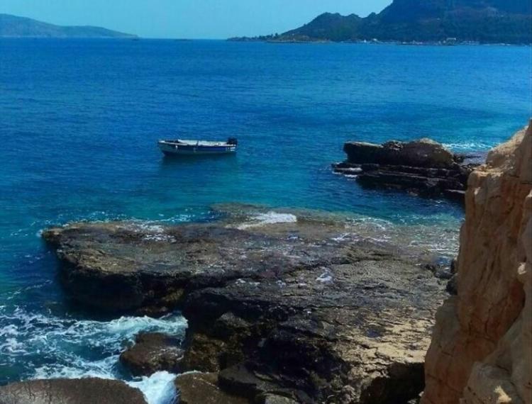 The Greek island that has no sandy beaches.